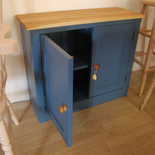 Wooden cupboard painted in Farrow & Ball